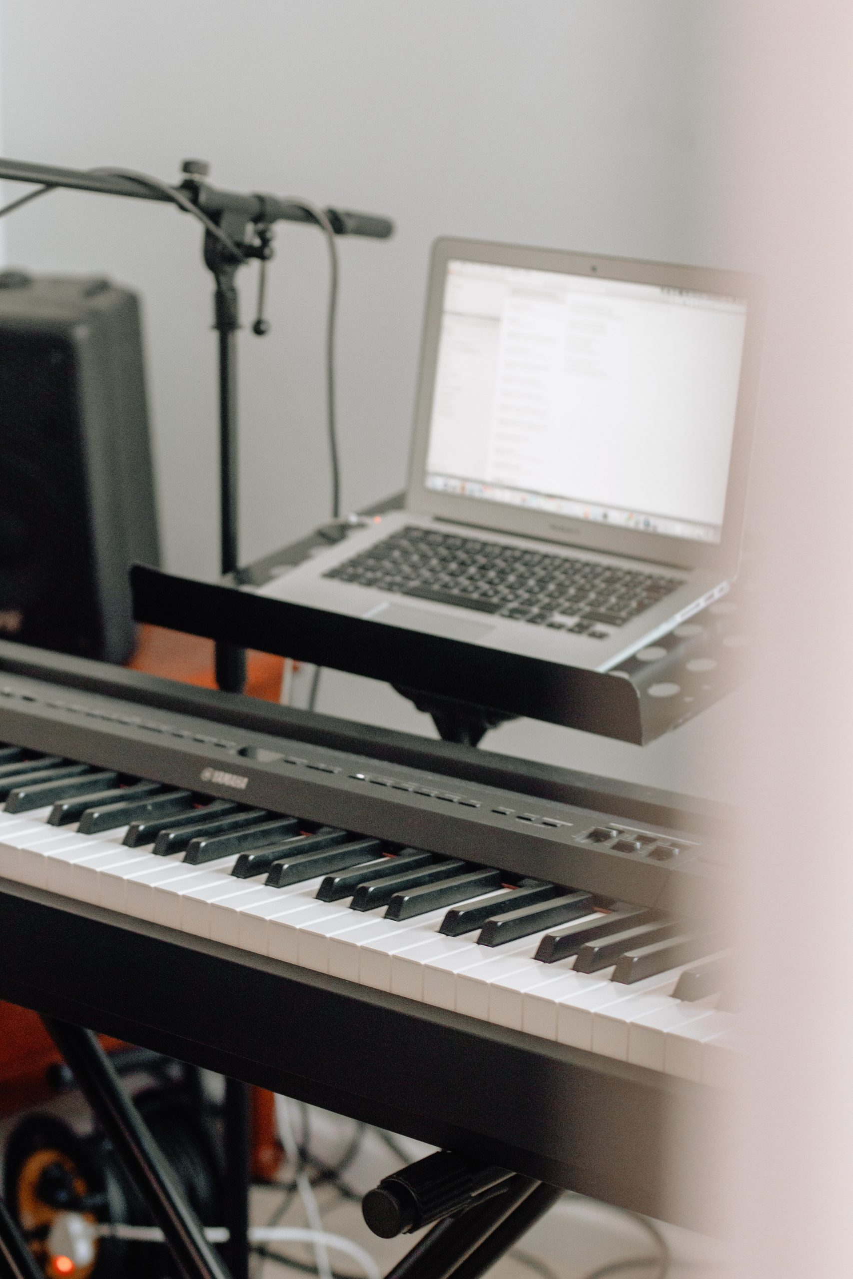 Online piano lesson with keyboard and laptop in Manchester