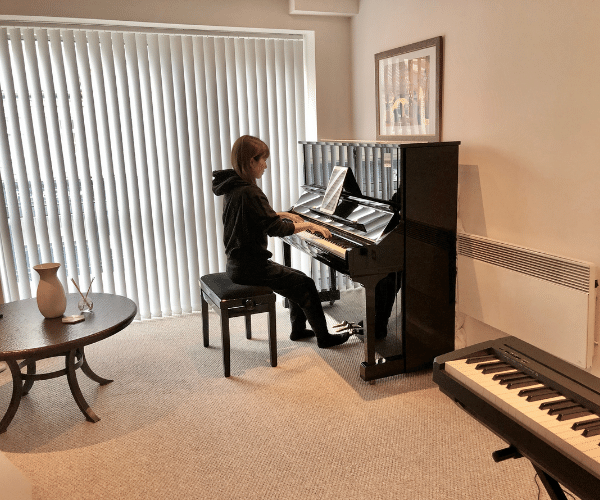 Piano Tuition Manchester Studio Room, Student playing Yamaha U3 Upright Piano during piano lesson