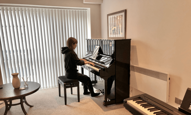 Piano student playing piano at PTM Studio in Manchester